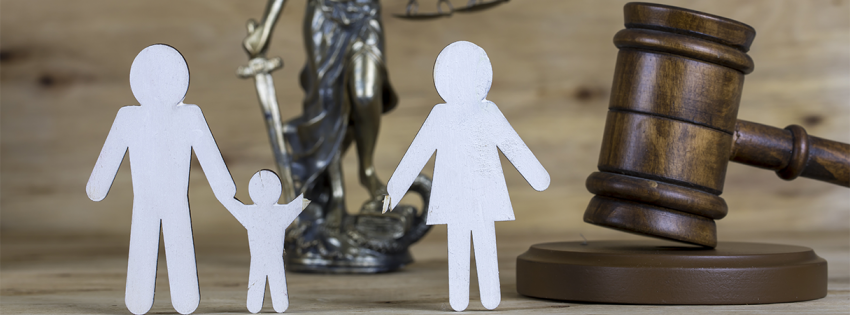 Gavel and a family separated from a child shown with paper figures