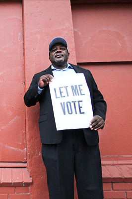 Dorsey Nunn with sign Let me Vote