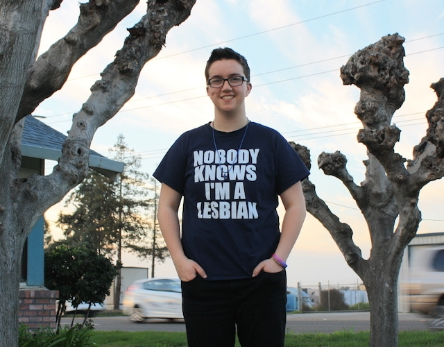 "ACLU client Taylor Victor wearing t-shirt that reads ""Nobody Knows I'm a Lesbian"""