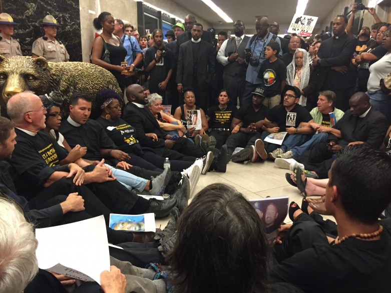 AB 953 direct action in front of Gov. Brown's office at the State Capitol.