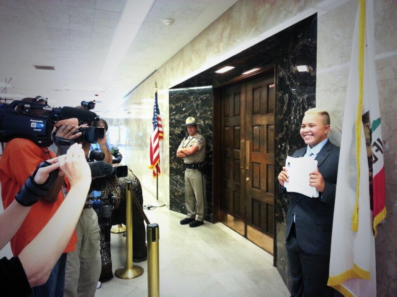 Ashton Lee delivering petitions to Gov. Brown