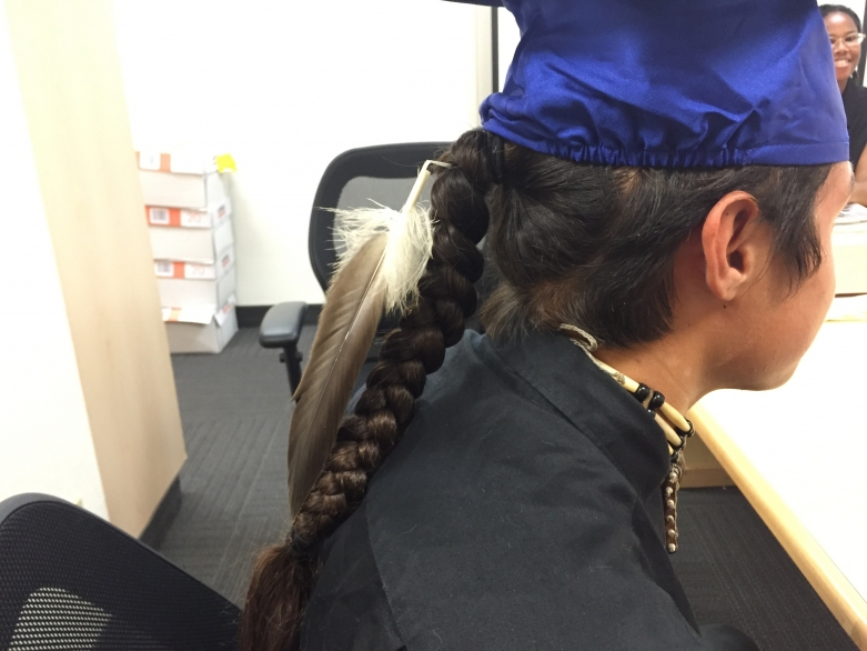 Eagle feather with graduation cap