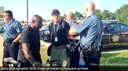 Getty photographer Scott Olson arrested at Ferguson protest.