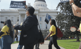 a group of ACLU supporters rally outside of the CA state Capitol