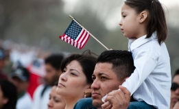 Latino family with American flag.