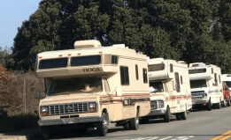 Cropped photo of RVs parked on a street in the city of Pacifica