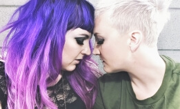 Sera and Frankie of band Unsung Lilly in pose where their foreheads are touching