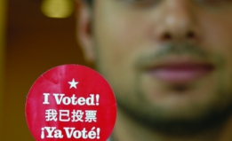 Individual holding vote sticker