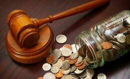 Coins in a jar with a gavel