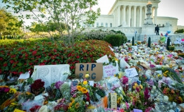 Flowers and notes in memory of Justice Ruth Bader Ginsburg