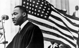 MLK with American flag