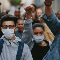 young people wearing masks protesting