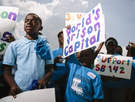 kids holding anti-prison signs